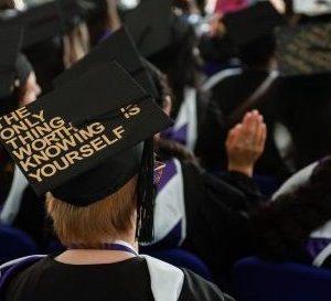 Graduate in crowd of graduates
